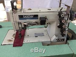 Brother industrial sewing machine 5 threads. Model# FD4-B272