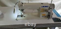 Juki DDL-8700 SEWING MACHINE WITH T-LEGS STAND, CASTERS, SERVO MOTOR LED LAMP
