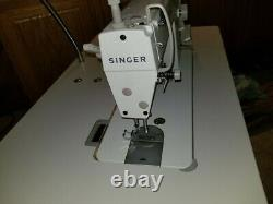 Singer Sewing Machine Model 2491 pre-owned with Table and Servo Motor Commercial